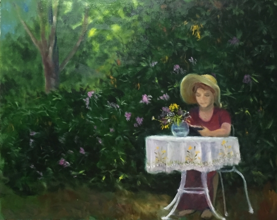 Reader at table with vase of flowers